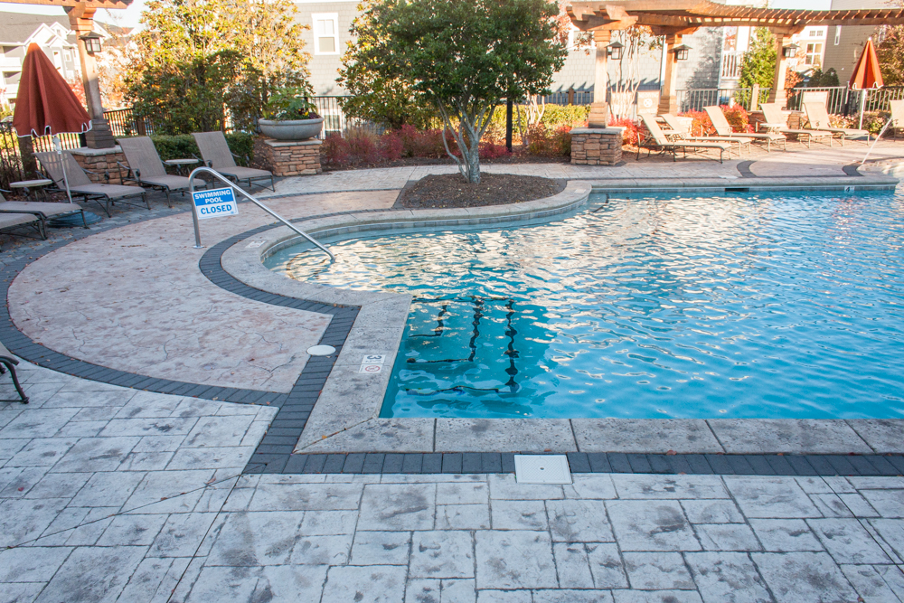 Artisan concrete solutions commecial pool decks for Cool decking around pool